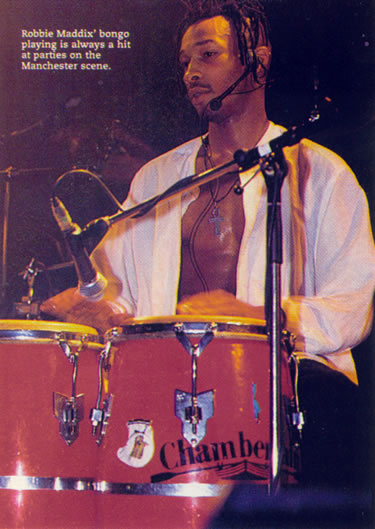 Robbie Maddix playing bongos
